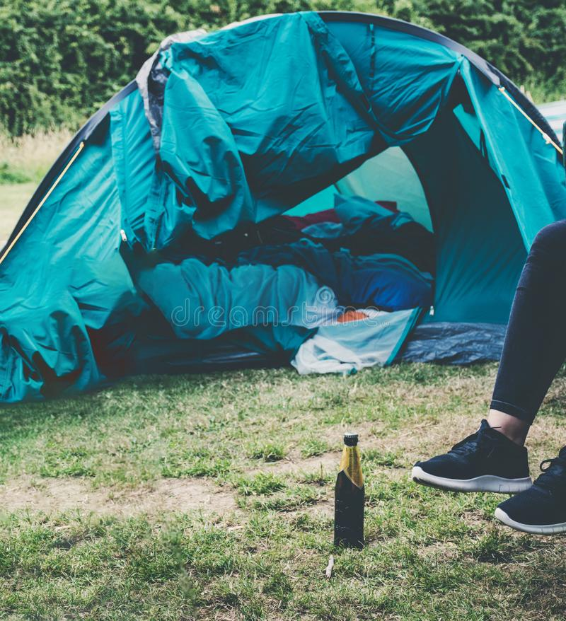 Sitting relaxed outside a tent. Feet of woman sitting relaxed outside a tent royalty free stock photo
