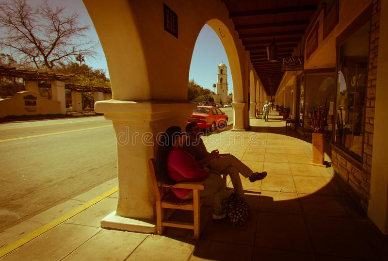 Sitting in the shade of an arcade on the mainstreet of ojai with. Ojai, United States - February 25 , 2013 : the main street down town, sitting in the shade stock photography