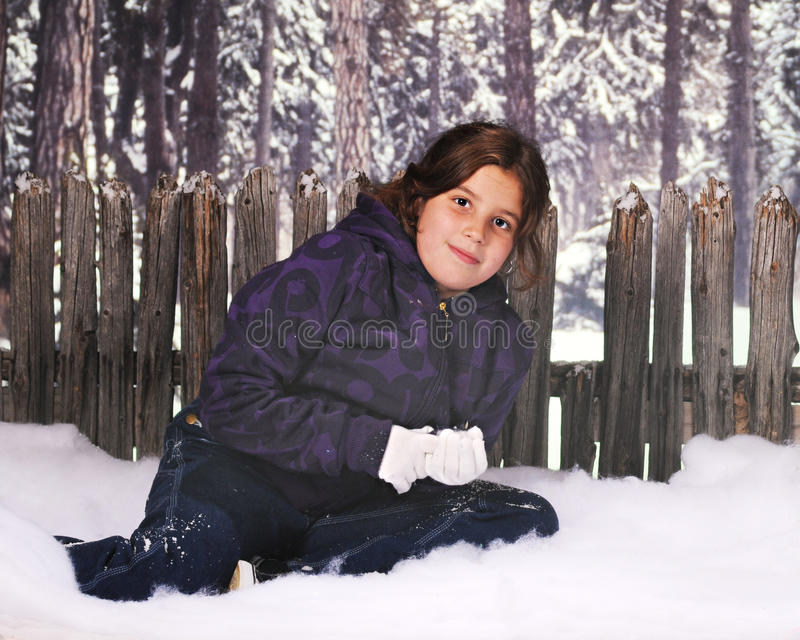 Download Sitting in Snow stock image. Image of fence, coat, young - 11322267