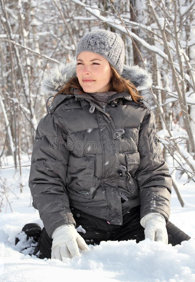 Sitting on snow royalty free stock photo