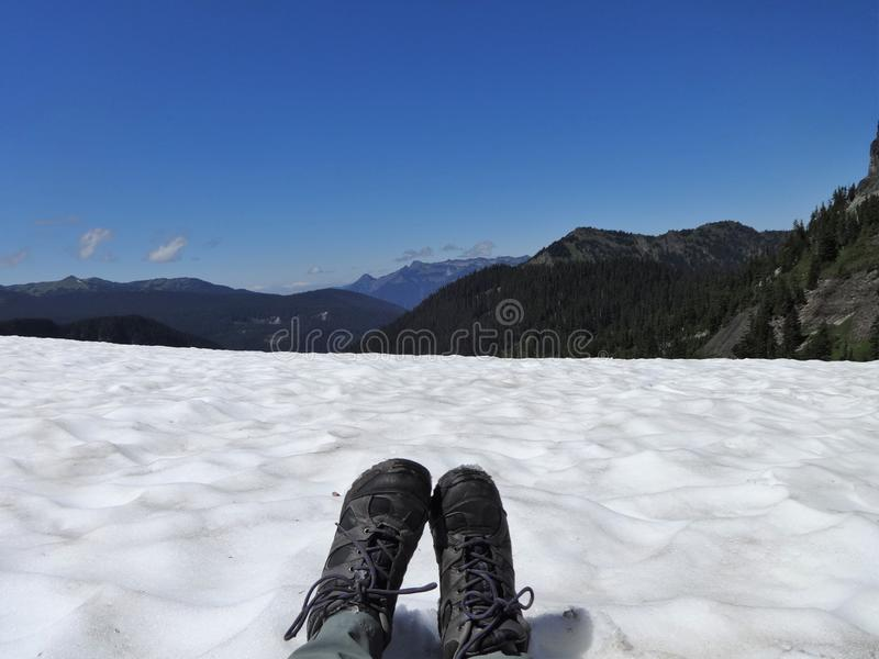 Sitting on a snow field royalty free stock photos