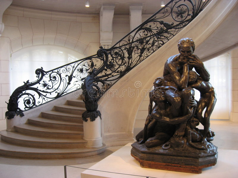 Sitting Statue and Stairs in Petit Trianon - Paris. A statue of a sitting man and a stair with iron adornments inside the Petit Trianon, Paris, France royalty free stock images