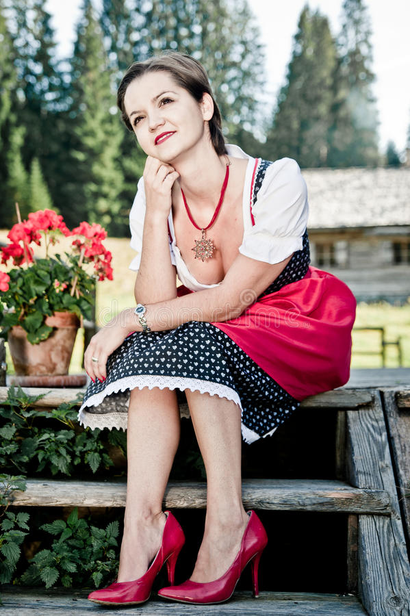 Download Sitting on the Steps stock photo. Image of dirndl, lifestyle - 21954182