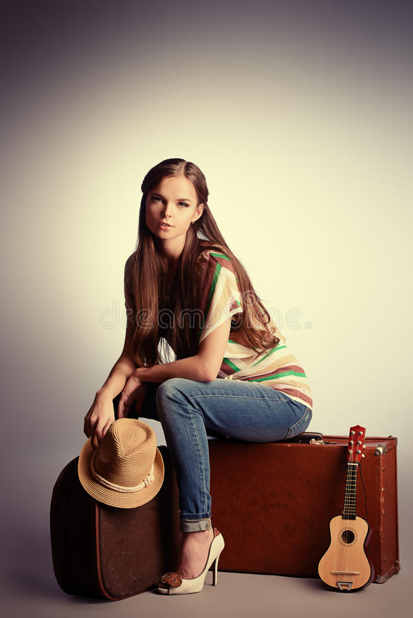 Sitting on suitcases royalty free stock photography
