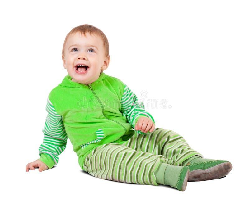 Sitting toddler. over white stock photos