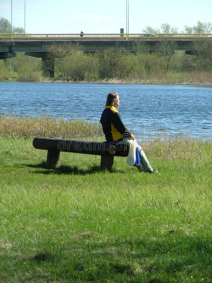 Download Sitting By The Water Royalty Free Stock Photos - Image: 130598