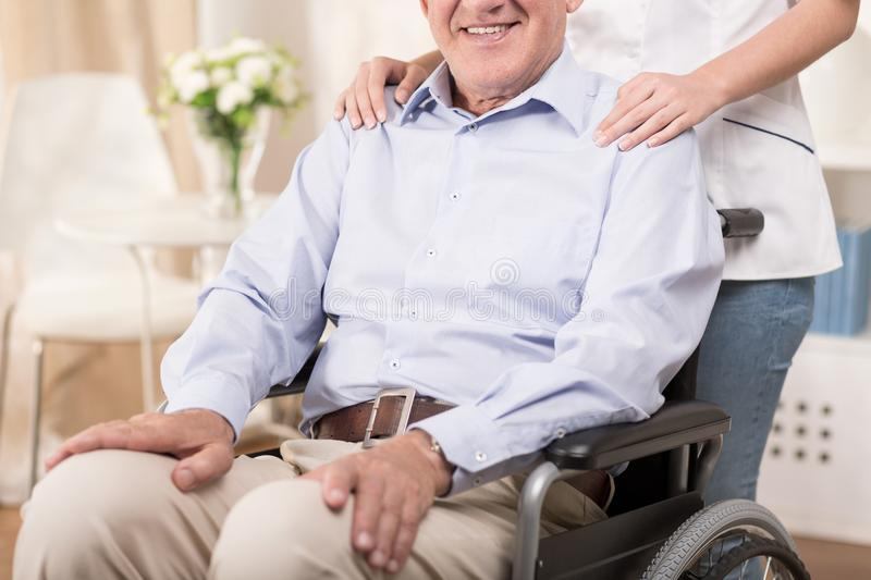 Sitting on the wheelchair royalty free stock photography