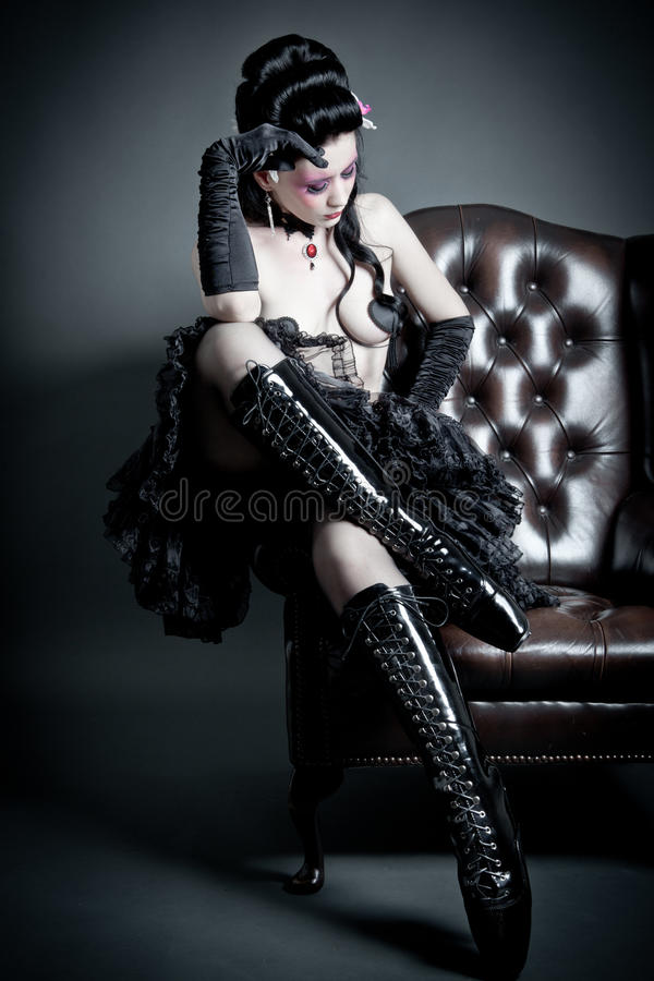Sitting Woman with ballett boots royalty free stock images