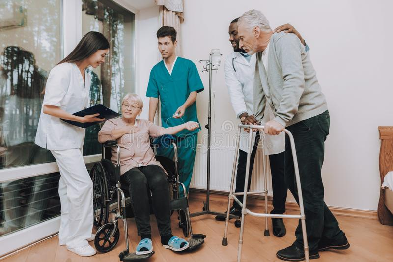 Sitting Woman with Dropper. Patient with Walker. stock photo