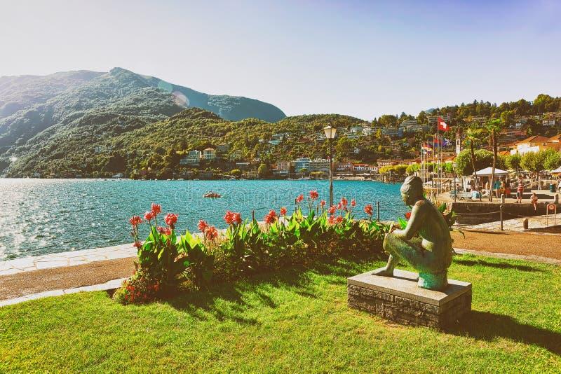 Woman sculpture at promenade Ascona in Ticino Switzerland summer stock image