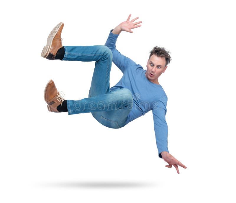 A situação, o homem está caindo Isolado no fundo branco Conceito de um acidente foto de stock