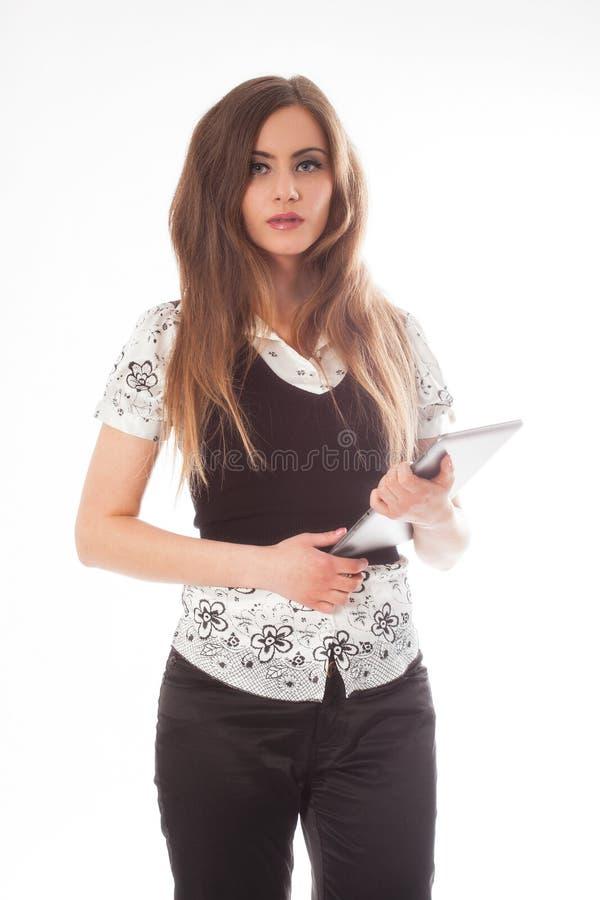 Situación de la mujer mientras que usa un panel táctil foto de archivo libre de regalías