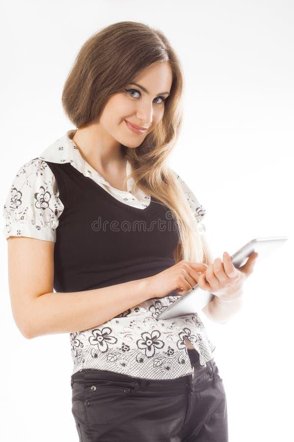 Situación de la mujer mientras que usa un panel táctil imagenes de archivo