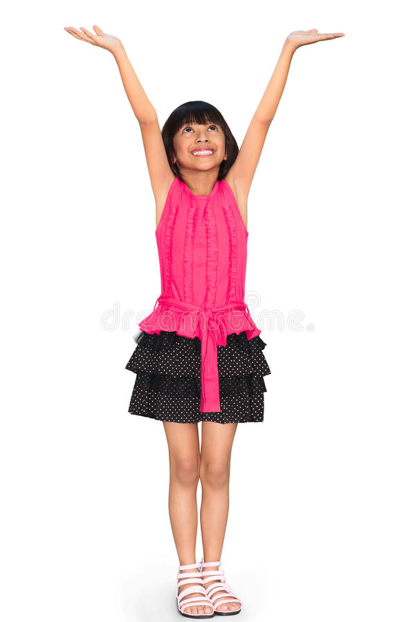 Situación de la niña y manos asiáticas de los asimientos para arriba foto de archivo