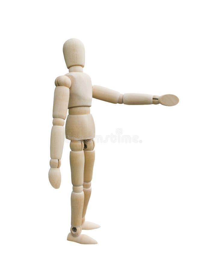 Situación de madera de la marioneta y señalar su mano a la izquierda fotos de archivo