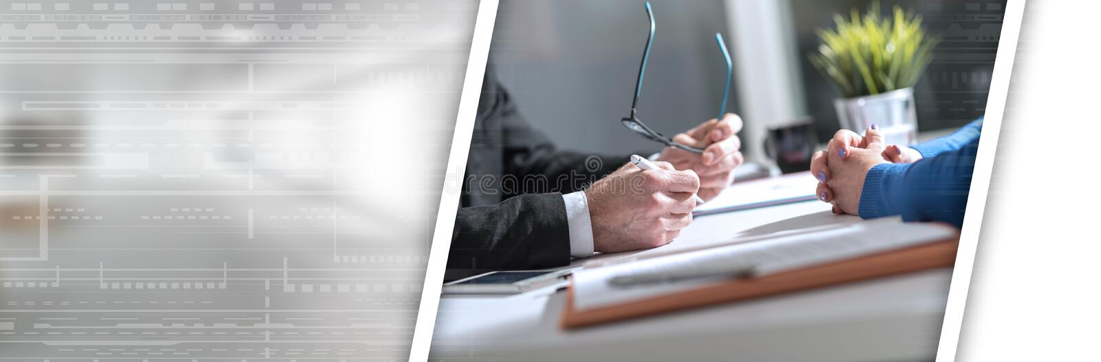 Business negotiation between businesswoman and businessman; panoramic banner stock photography