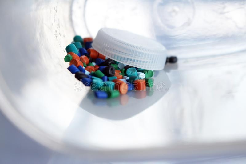 Situation, eat the plastic, polymers. A spoon full of plastic granules. Indicates how much plastic we eat, and we leave the environment stock photos
