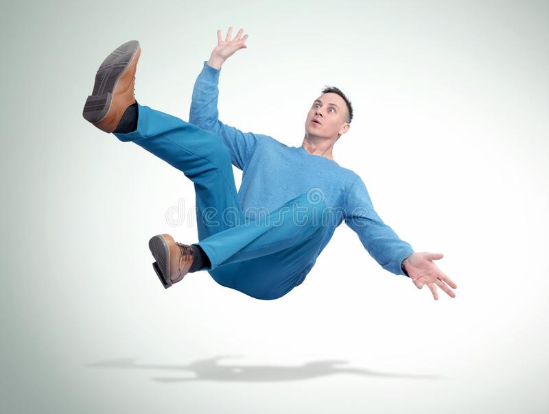 Situation, the man in casual clothes is falling. Concept of an accident royalty free stock image