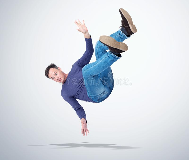 Situation, the man in casual clothes is falling. Concept of an accident royalty free stock photography