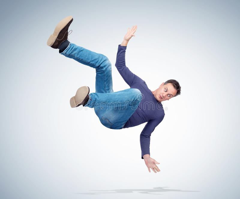 Situation, the man in casual clothes is falling. Concept of an accident stock photography