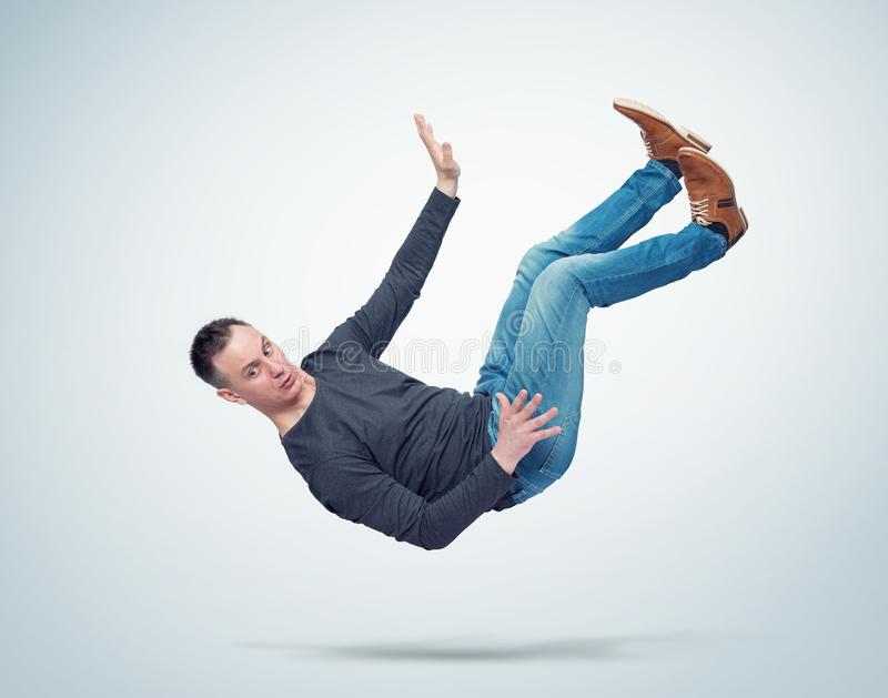 Situation, the man in casual clothes is falling down. Concept of an accident stock photography