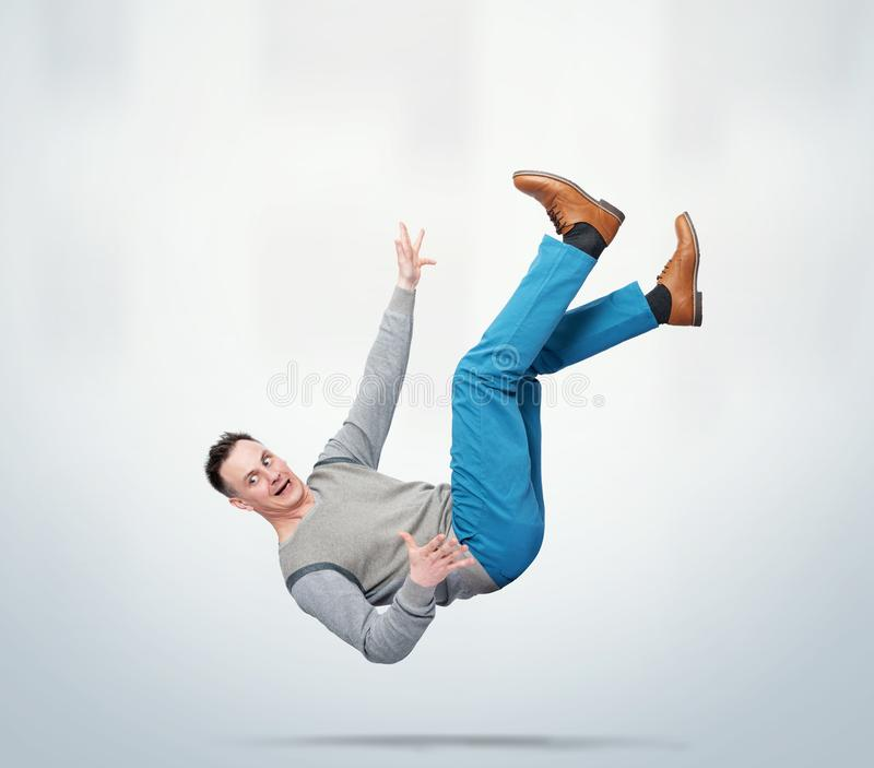 Situation, the man in casual clothes is falling down. Concept of an accident royalty free stock image