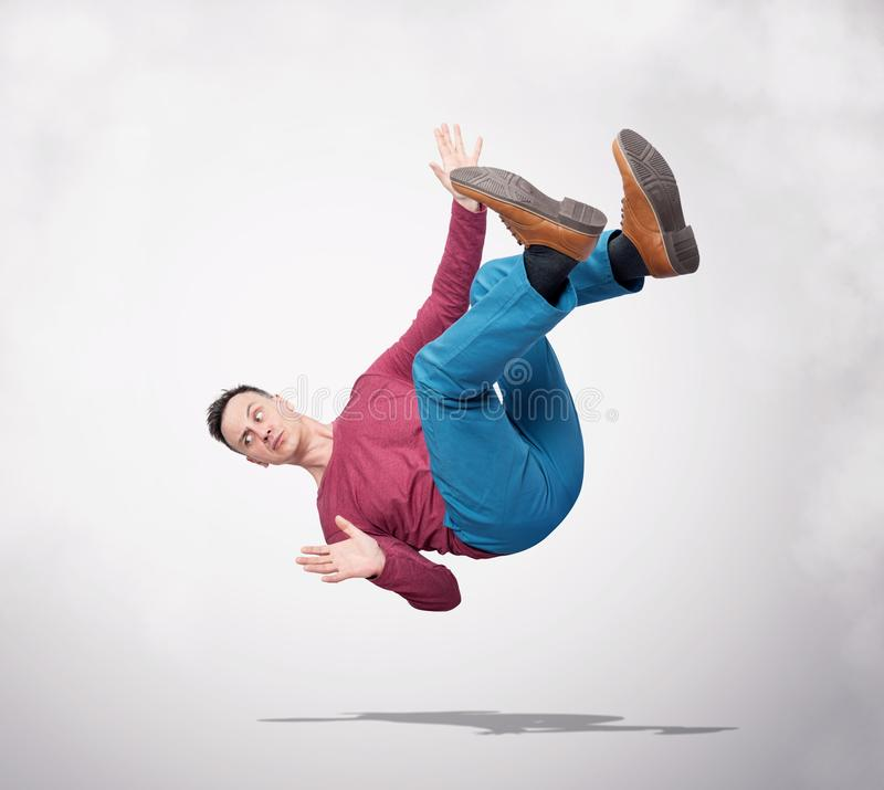 Situation, the man in casual clothes is falling down. Concept of an accident royalty free stock photography