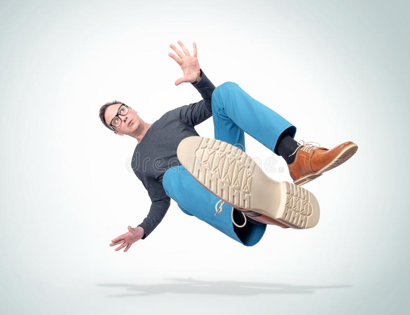 Situation, the man in casual clothes and glasses is falling down. Concept of an accident stock photos