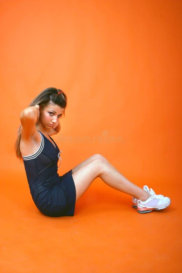 Download Situp Teen Profile stock image. Image of exertion, orange - 1421003