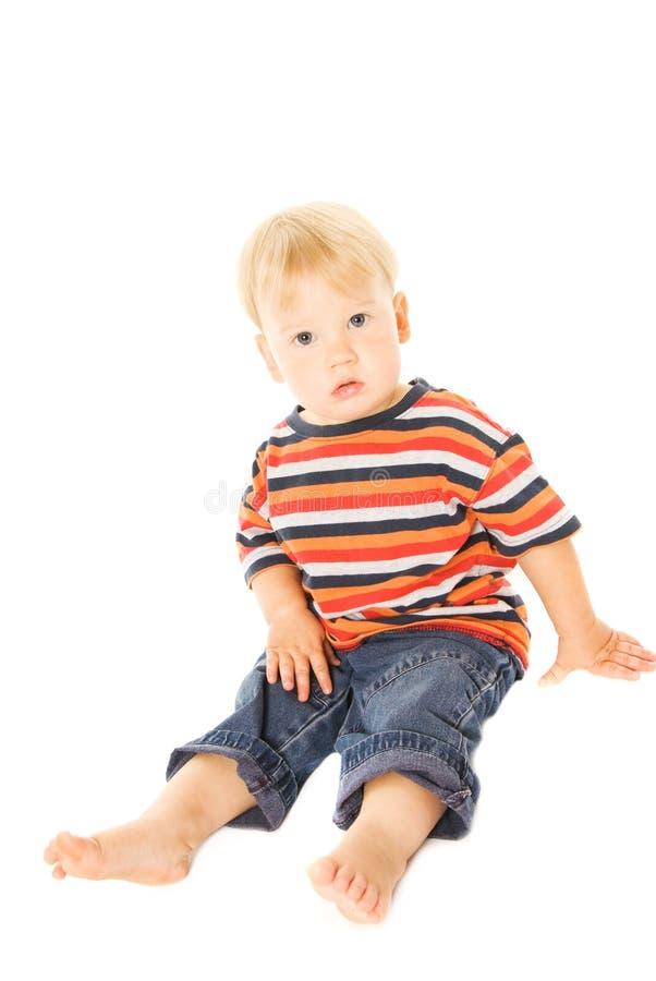 Sitzen des schönen Kindes stockbilder
