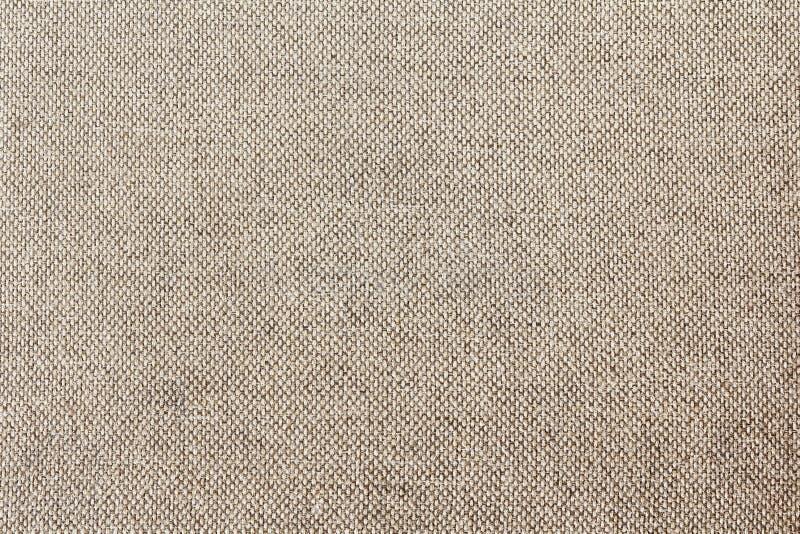 Sitzen gesponnene Segeltuchpastellmuster Brown-Sepia vom Boden Hintergrund vor lizenzfreies stockbild