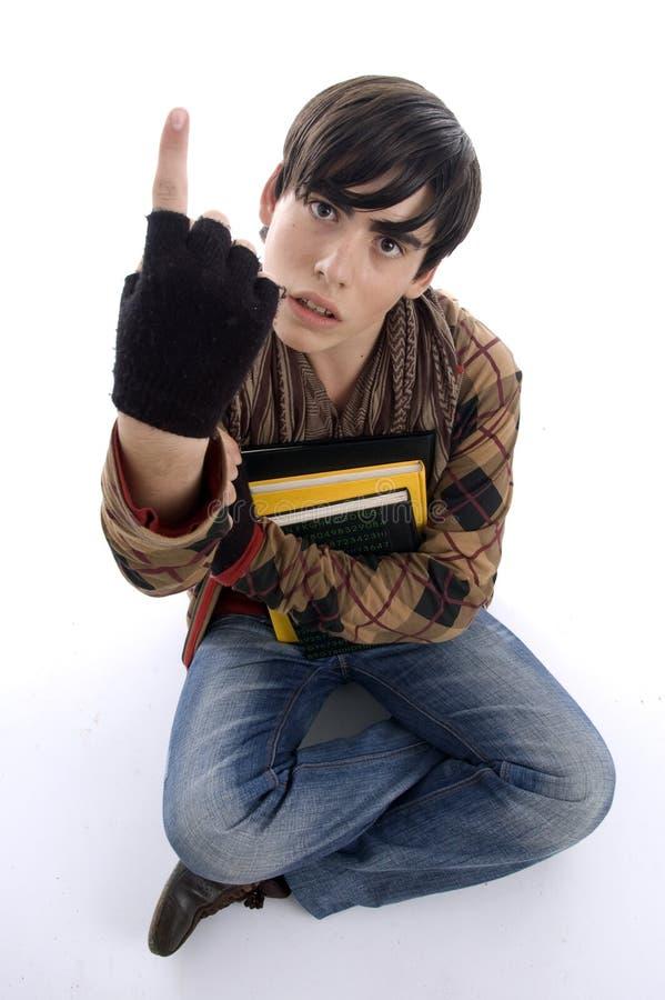 Sitzender Kursteilnehmer, der Finger zeigt stockbild