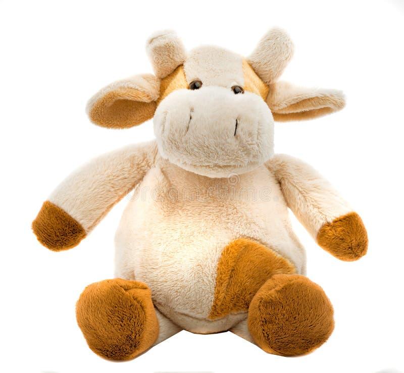 Sitzendes weiches Spielzeug der Kuh stockbild