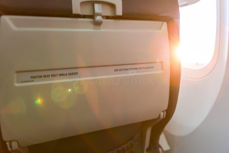 Sitzzeichen auf Flugzeug befestigen sich stockbilder