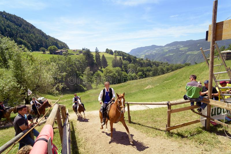 SIUSI ALLO SCILIAR, ITALY - JUNE 2017: Unidentified people by yearly horse-riding event named. `Oswald von Wolkenstein Ritt` in South Tirol, on June 10, 2017 in royalty free stock images