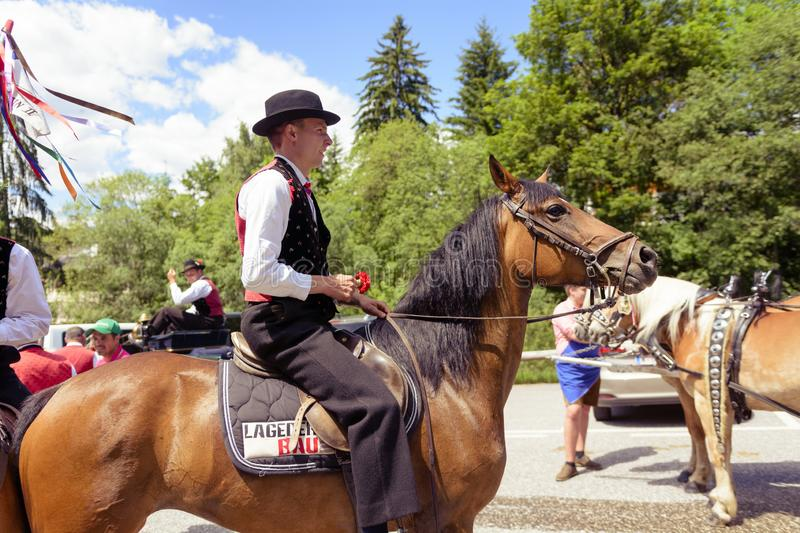 SIUSI ALLO SCILIAR, ITALY - JUNE 2017: Unidentified people by yearly horse-riding event named. `Oswald von Wolkenstein Ritt` in South Tirol, on June 10, 2017 in royalty free stock photo