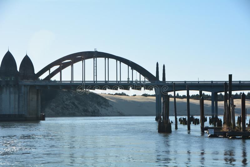 Siuslaw River Bridge, Oregon Coast. The Siuslaw River Bridge is a bascule bridge that spans the Siuslaw River on U.S. Route 101 in Florence, Oregon royalty free stock image