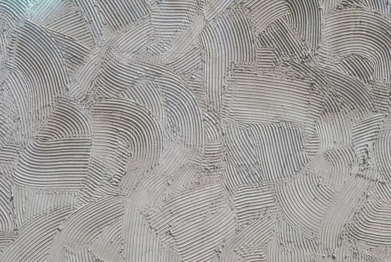 Siwieje dekoracyjnego reliefowego tynk na ścianie, tło tekstura zdjęcia stock