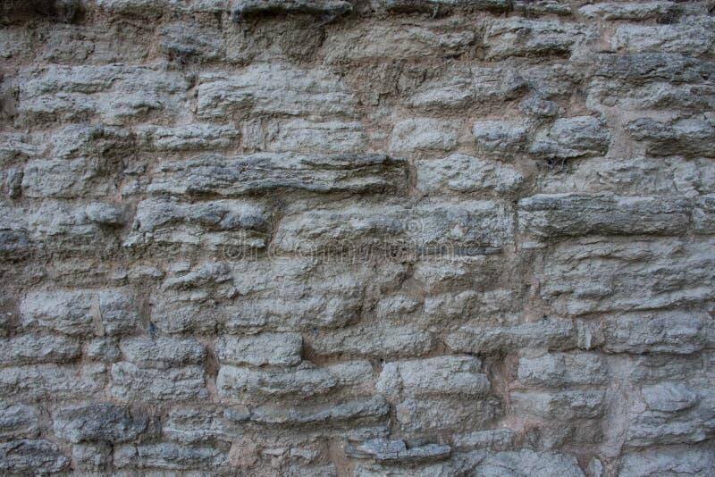 Siwieje kamiennego starego ściennego tło obraz stock