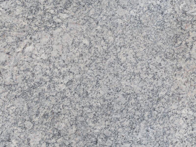 Siwieje naturalnego bezszwowego granitu kamienia tekstury wzoru tło Granitowa bezszwowa wzór powierzchnia ciemni i jasnopopielaci fotografia royalty free