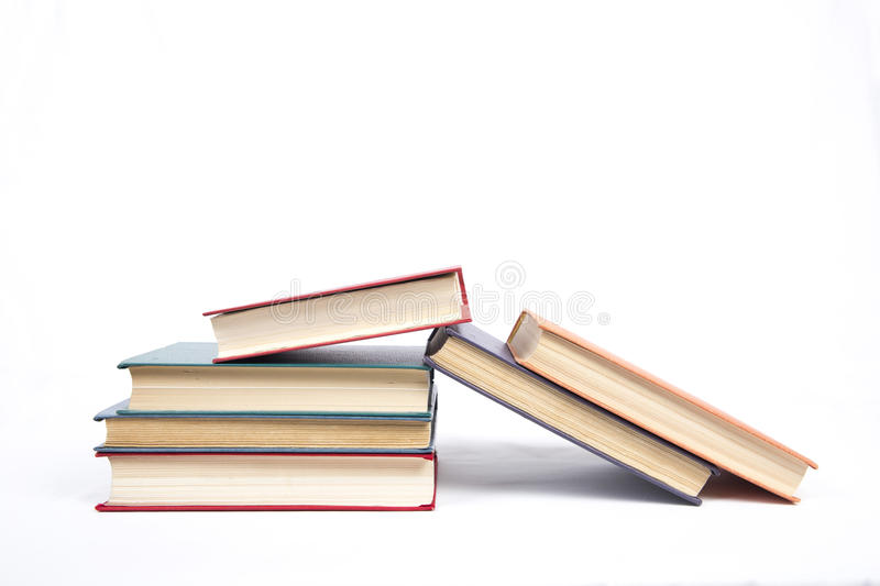 Six books in hardcover. On a white background royalty free stock image