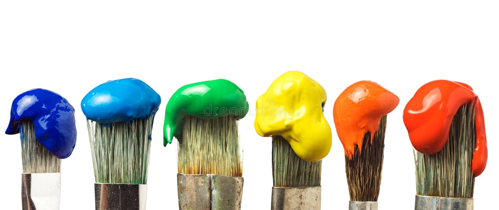 Six brushes with paint royalty free stock image