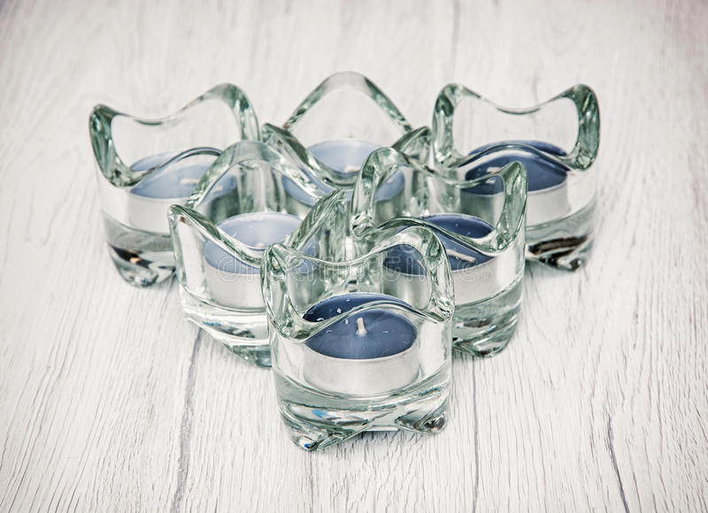 Six candlesticks of glass with tea lights, religious theme royalty free stock photo