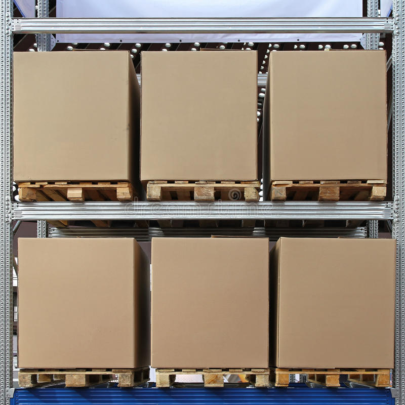 Pallets boxes. Six carboard boxes at pallets in distribution warehouse royalty free stock photo