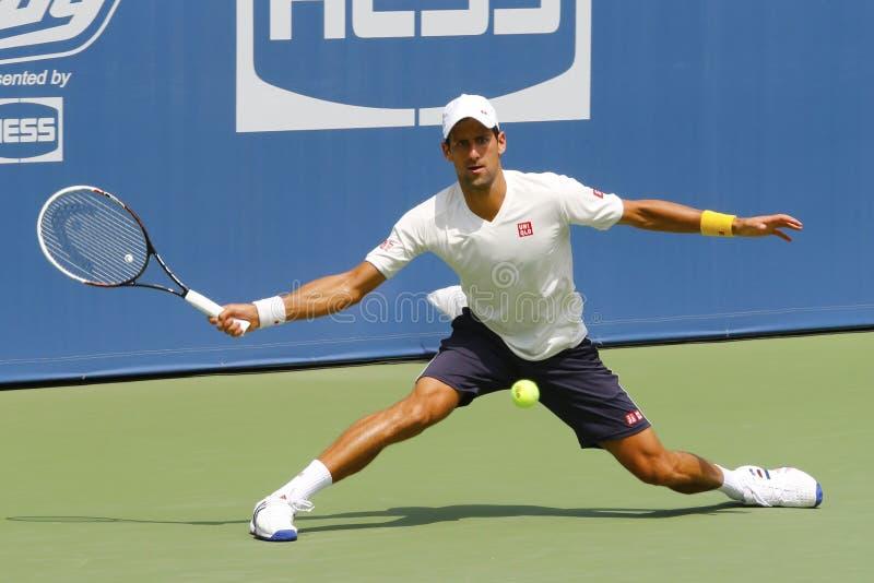 Six champions Novak Djokovic de Grand Chelem de périodes pratiquent pour l'US Open 2014 photographie stock