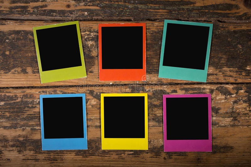 Six color frames on wooden background stock photo