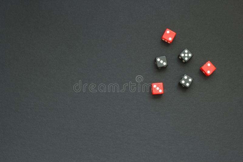 Six colored dice on a dark fabric royalty free stock image