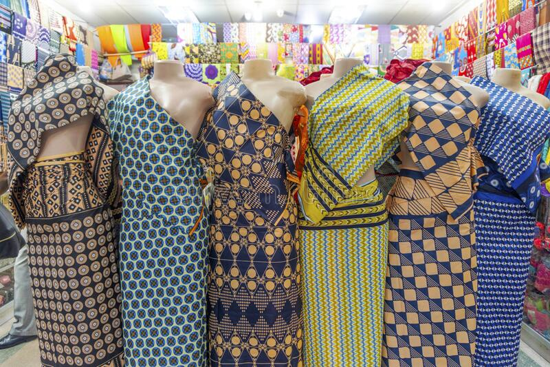 Six colorful African fabrics presented as dresses on mannequins in Mozambique. Six colorful African fabrics presented as dresses on mannequins in Maputo royalty free stock photos