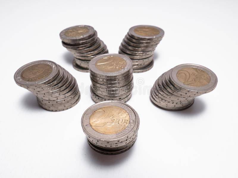 Six columns formed by two euro coins on white background stock photos