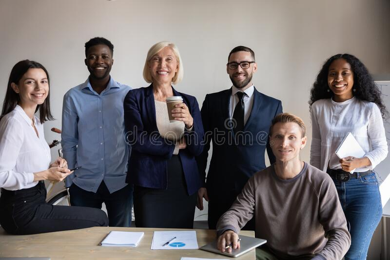 Six confident businesspeople international department successful employees posing in office stock image